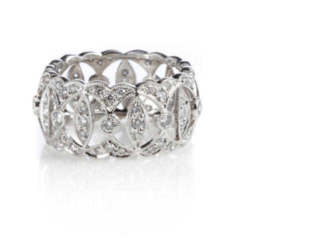 A diamond and 14k white gold wide band ring