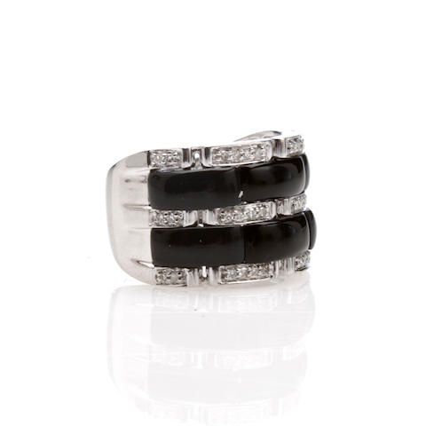 A black onyx, diamond and 14k white gold ring