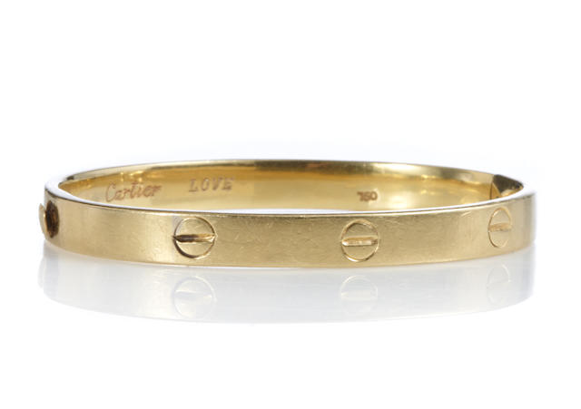 "An 18k gold ""Love"" bangle,"