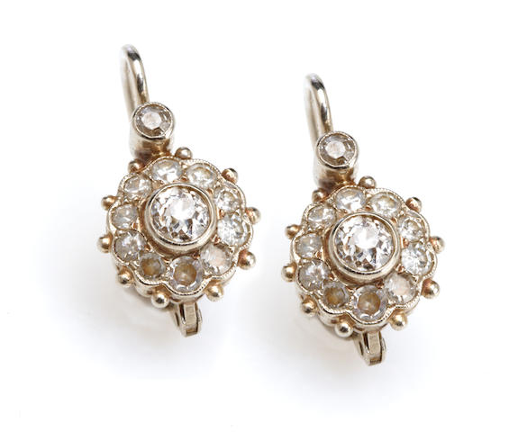 A pair of diamond and white gold earrings