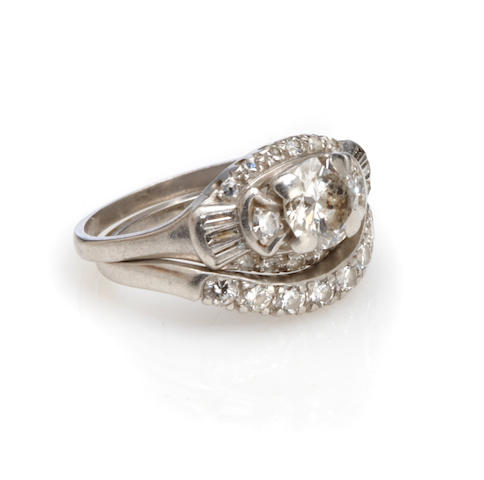 A diamond and platinum ring and band set
