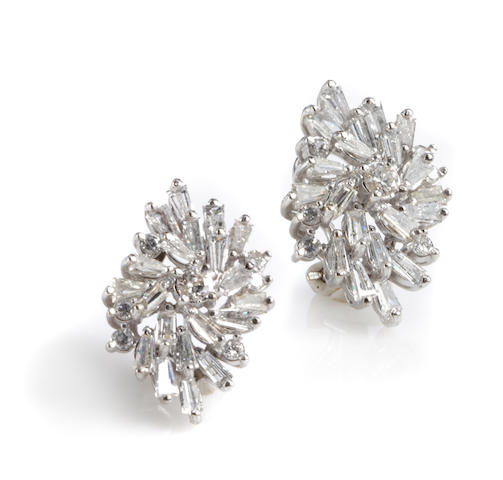 A pair of diamond and white gold cluster earclips
