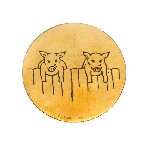 "An enamel and fourteen karat gold ""heads or tails"" coin, Cartier"