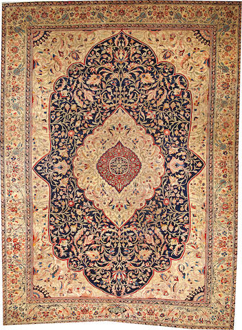 A Tabriz carpet  Northwest Persia size approximately 10ft. 1in. x 13ft. 8in. Northwest Persia size approximately 10ft. 1in. x 13ft. 8in.