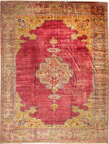 A silk Tabriz carpet  Northwest Persia size approximately 10ft. 6in. x 13ft. 10in.