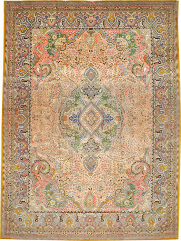 A Tabriz carpet Northwest Persia size approximately 9ft. 11in. x 13ft. 4in.