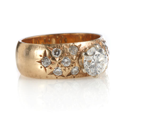 A diamond and 14k gold band