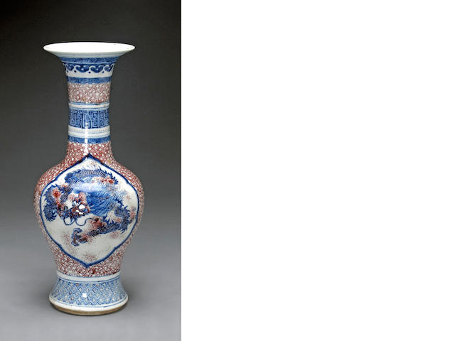 A porcelain baluster vase with underglaze blue and copper red decoration 19th century