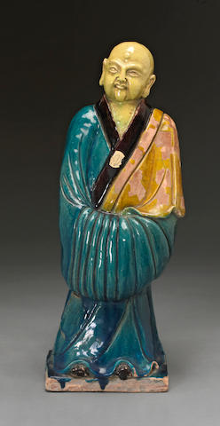 A sancai glazed pottery figure of an arhat 19th century