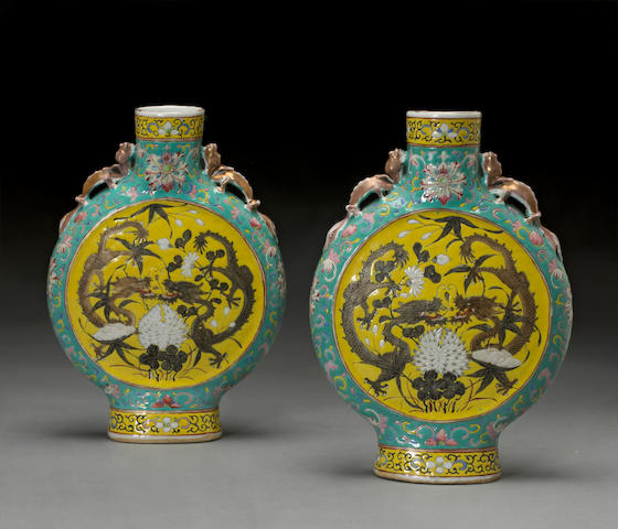 A pair of polychrome and gilt enameled porcelain moon flasks Late 19th century