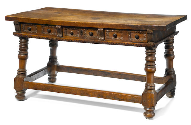 A Spanish Baroque carved walnut library table <BR />second half 17th century base possibly made up of antique elements