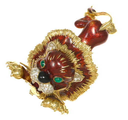 An enamel, diamond and green onyx lion brooch