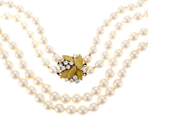 A cultured pearl and diamond double strand necklace