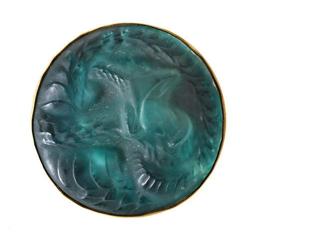 "A green molded glass ""Serpent"" brooch, René Lalique,"