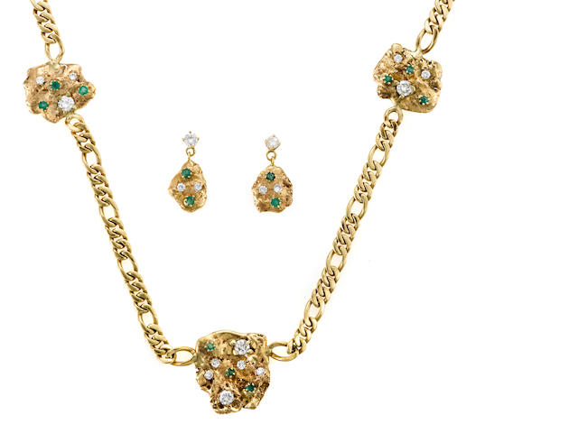 A diamond, emerald and fourteen karat gold nugget motif necklace together with a matching pair of earrings