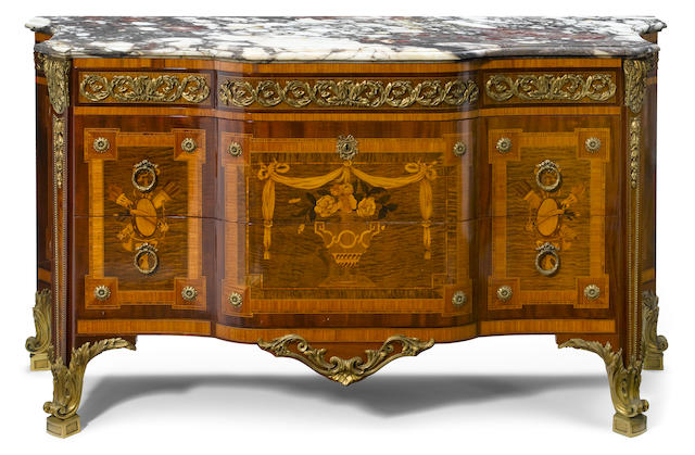 A Louis XVI style gilt bronze mounted mixed hardwood veneered marquetry marble top commode