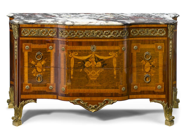 A Louis XVI style gilt bronze mounted marquetry inlaid commode  after a model by Jean-Henri Riesener 20th century