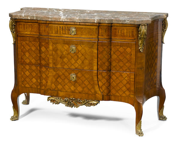 A Louis XVI style mixed hardwood veneer ornated parquetry gilt metal mounted marble top commode <BR />late 19th century