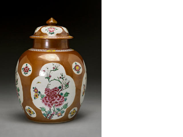 A cafe-au-lait glazed porcelain covered jar with famille rose decoration 19th century