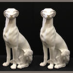 A pair of Italian white glazed ceramic models of seated hounds Vellum