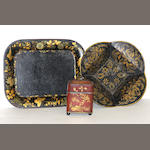 A chinoiserie tôle tea caddy and two trays 19th century