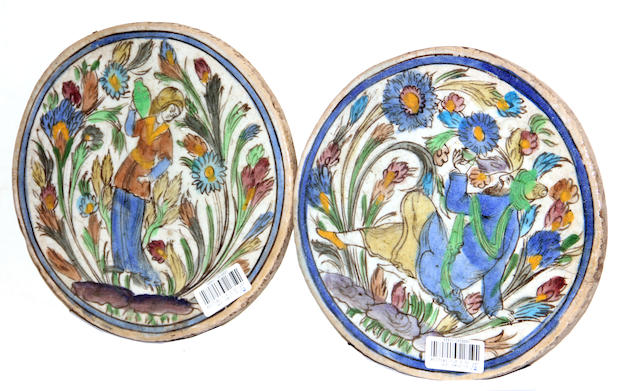 A pair of Persian circular faience tiles
