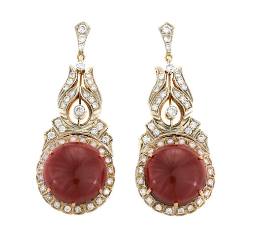 A pair of garnet and diamond pendant earrings