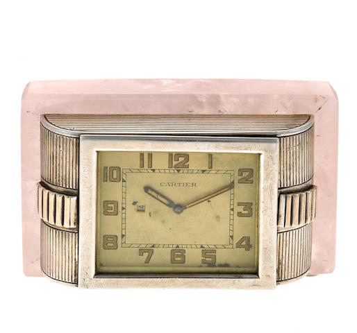 A silver clock with rose quartz base, Cartier, London,