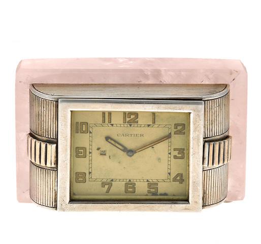 A silver clock with rose quartz base, Cartier, London,