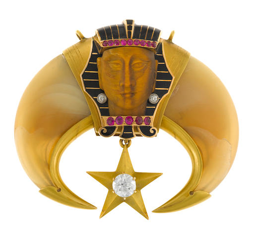 An Egyptian revival tiger's eye, claw, diamond, synthetic ruby, enamel and cubic zirconia pendant