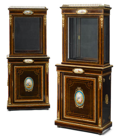 A pair of French gilt bronze and porcelain mounted mahogany vitrine cabinets
