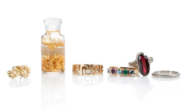 A group of gem-set, metal and gold items