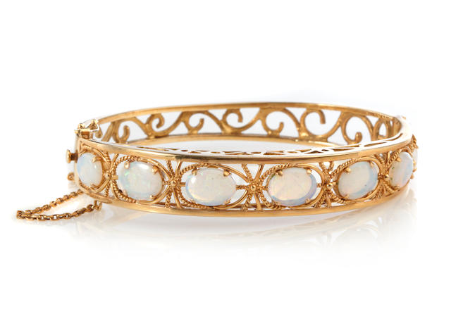 An opal and 14k gold bangle bracelet