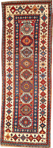 A Kazak runner Caucasus size approximately 3ft. 6in. x 10ft. 1in.