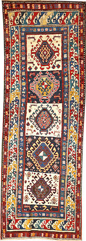 A Kazak runner  Caucasus size approximately 3ft. 8in. x 10ft. 5in.