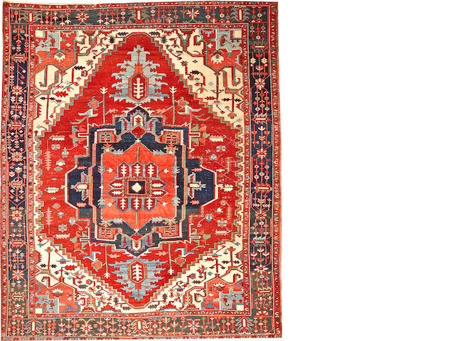 A Serapi carpet  Northwest Persia size approximately 9ft. 2in. x 11ft. 1in.
