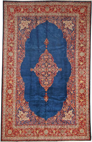 A Sarouk long carpet  Central Persia size approximately 7ft. 11in. 12ft. 8in.