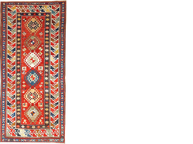 A Kazak rug  Caucasus size approximately 3ft. 11in. x 8ft. 7in.