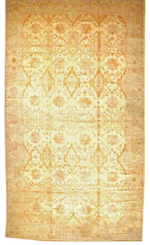 An Oushak carpet  West Anatolia size approximately 12ft. 5in. x 22ft.