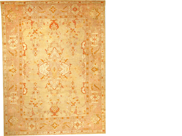 An Oushak carpet  West Anatolia size approximately 10ft. 2in. x 13ft. 5in.