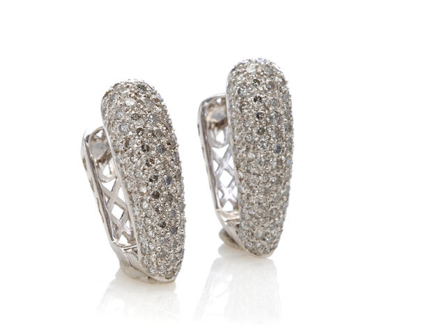 A pair of diamond and 14k white gold earrings