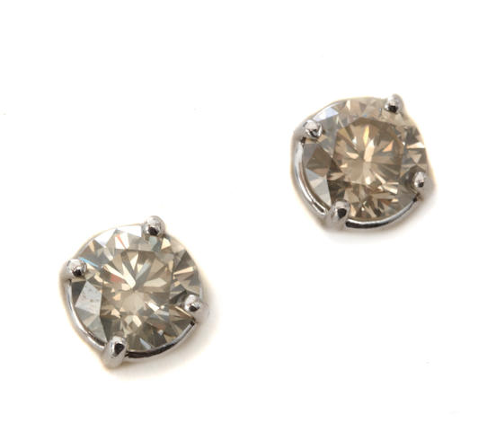 A pair of colored diamond and 14k white gold earring studs