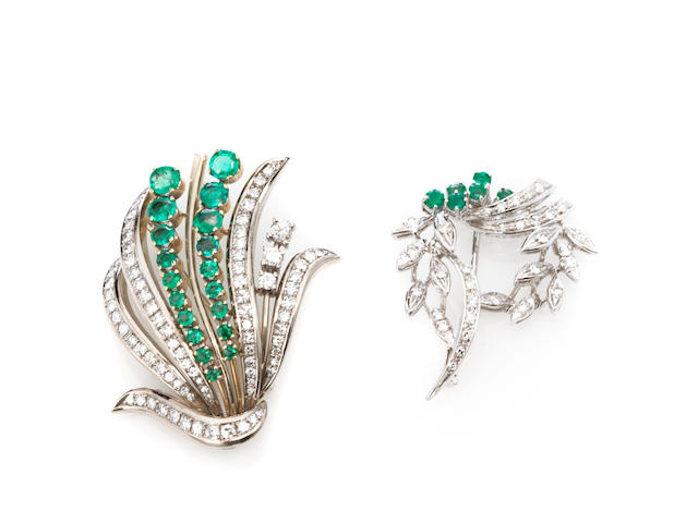 A group of two emerald, diamond and bicolor gold brooches
