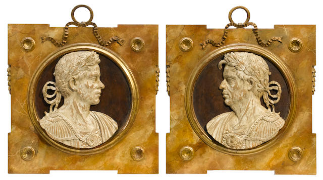 A pair of Grand Tour faux marble portrait plaques of Roman noblemen <BR />probably 20th century