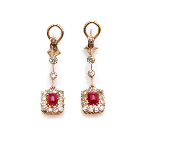 A pair of diamond, ruby and gold pendant earrings