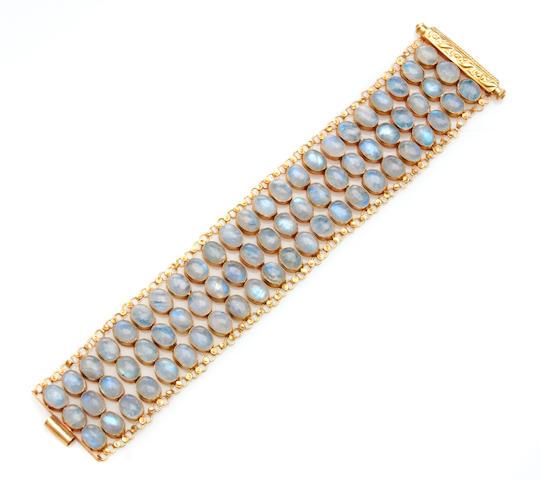 A labradorite feldspar and gold wide bracelet