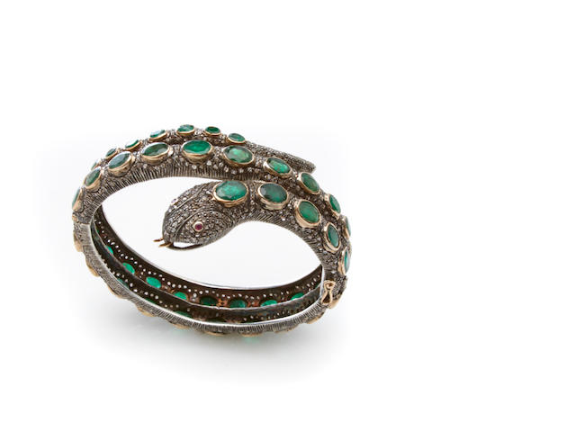 An emerald, silver-topped gilt gold snake bangle