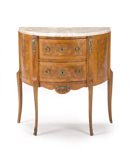 A Louis XV/Louis XVI transitional style metal mounted parquetry commode first quarter 20th century