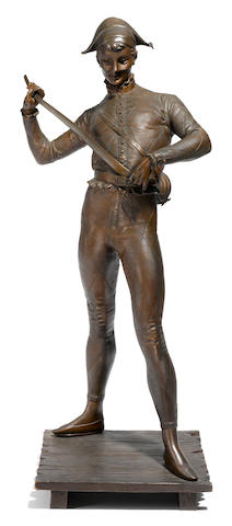 A French patinated bronze figure of a harlequin <BR />after a model by Paul Dubois (French, 1829-1905)<BR />late 19th century