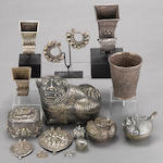 A group of Asian silver: including four Indian pendants, one Indian or Islamic deep cup, three horn shaped Indonesian betel nut containers, one Burmo-Thai octagonal covered box, three Cambodian style animal shaped covered boxes, two miniature betel nut boxes and two earrings from the Dong trip, China